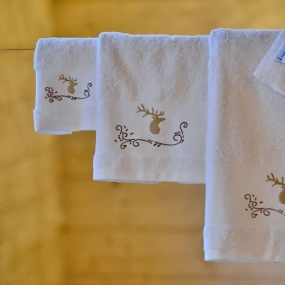 Stag on white guest towel