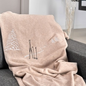 Taupe blanket with ski