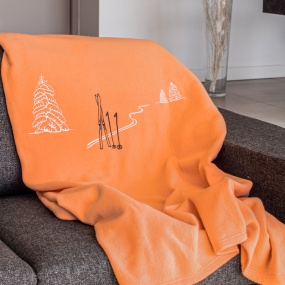 Oange blanket with Ski