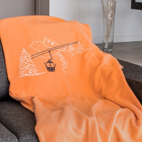 Cable car orange blanket