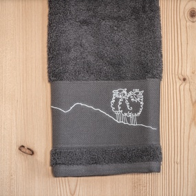 Grey bath towel with sheep