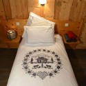 Duvet cover with black edelweiss flowers embroidered